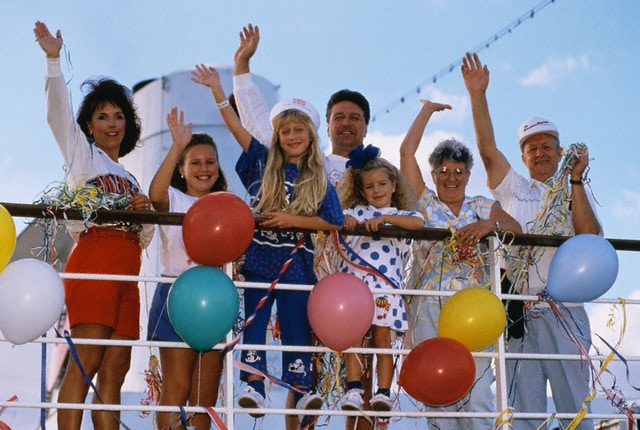 Family Waving from a Cruise Ship